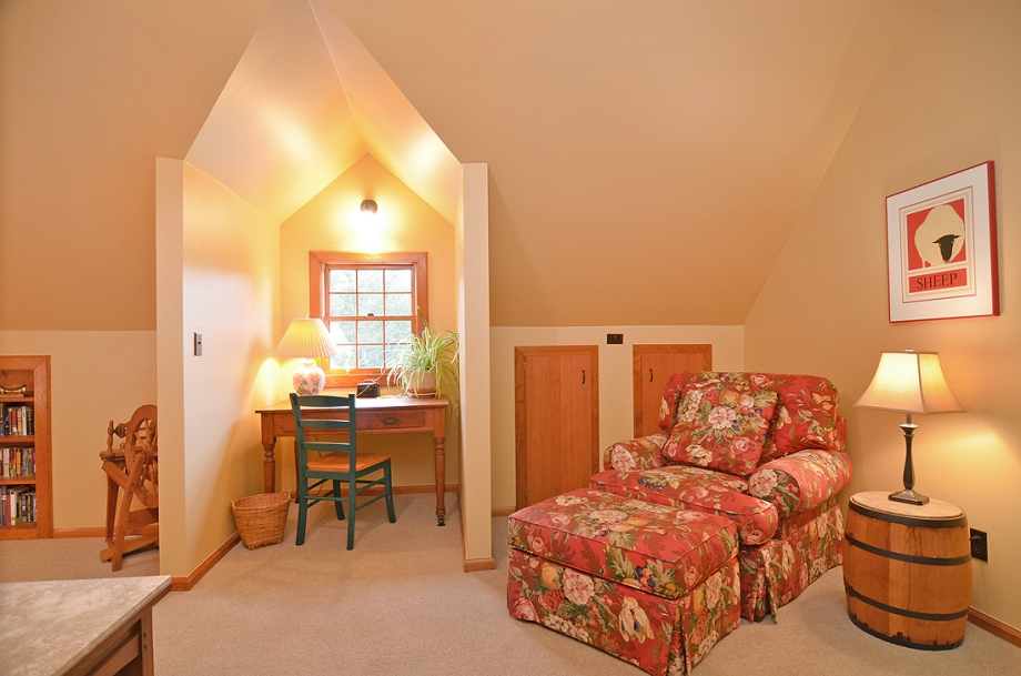 Small desk with window overlooking gardens is big enough for your laptop and free wifi is included during your stay.